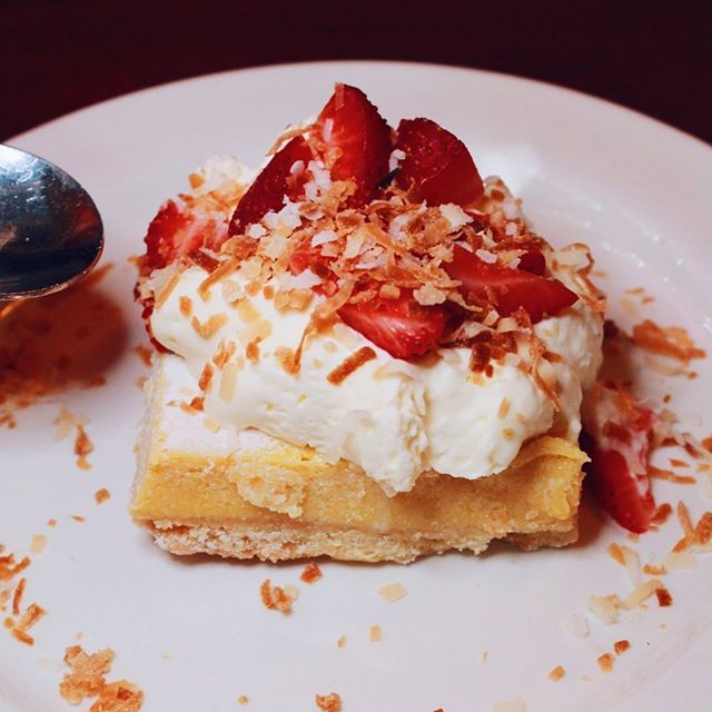 Passionfruit custard, coconut short dough, whipped cream, and strawberries make this Liliko-Coconut Tart impossible to decline ⁠#Sponsored ⁠⠀ ⁠⠀ Find this dessert *for a limited time only* among my favorite standby @McMenamins dessert the Black & Tan Brownie⁠. The only thing missing is a cold handcrafted McMenamins IPA to cleanse your palate.⁠ Stop by McMenamins Rams Head to check out their extensive list of burgers and this delicious dessert!⁠⠀ ⁠⠀ #mcmenamins #traveloregon #⁠mcmenaminsramshead⁠⠀ ⁠⠀ -⁠⠀ -⁠⠀ -⁠⠀ -⁠⠀ ⁠⠀ ⁠⠀ ⁠⠀ ⁠⠀ ⁠⠀ ⁠⠀ #maxeneeatspdx #eaterpdx #portland #chasinglight #topcitybites #yelpeatspdx  #portlandfood #travelportland #onthetable #dishedpdx #tastemade #heresmyfood #foodcoma #zagat #portlandfoodie #eatfamous⁠⠀ #insiderfood #foodspotting #gloobyfood