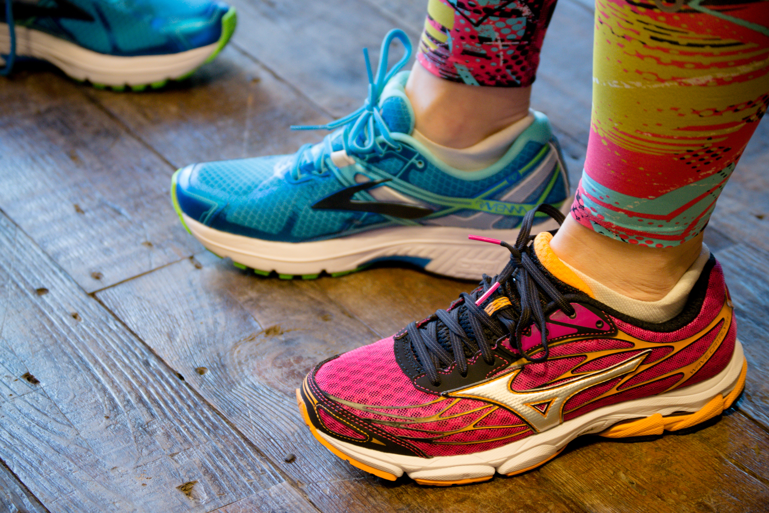 The blue Brooks Ravenna and Pink Mizuno Wave Catalyst battle it out.