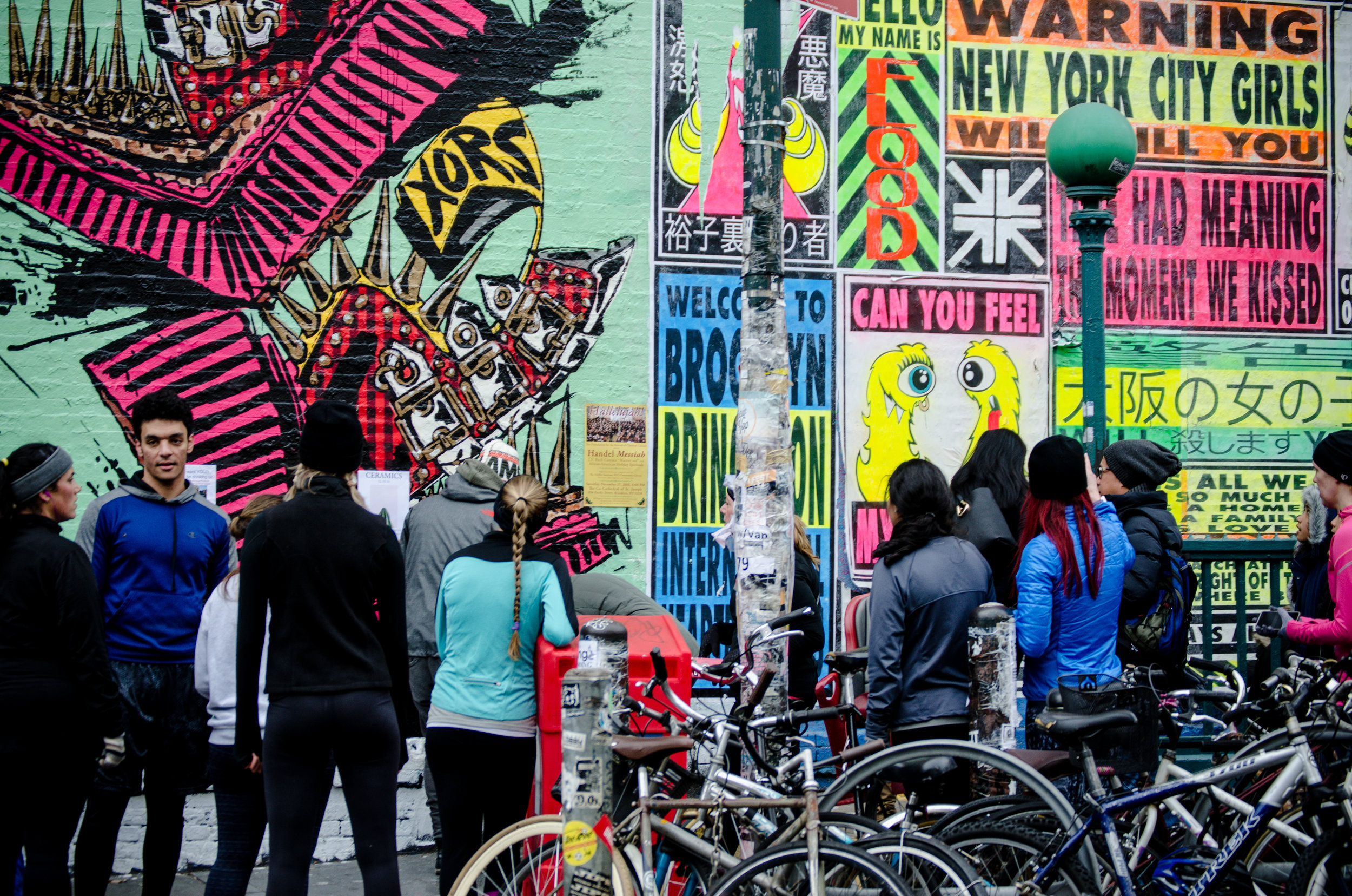 Runstreet Art runners in Williamsburg stop to admire Xors' and Flood Club's epic mural on Bedford Ave off the L stop in Brooklyn.Photo by Filles Garcons Photography.