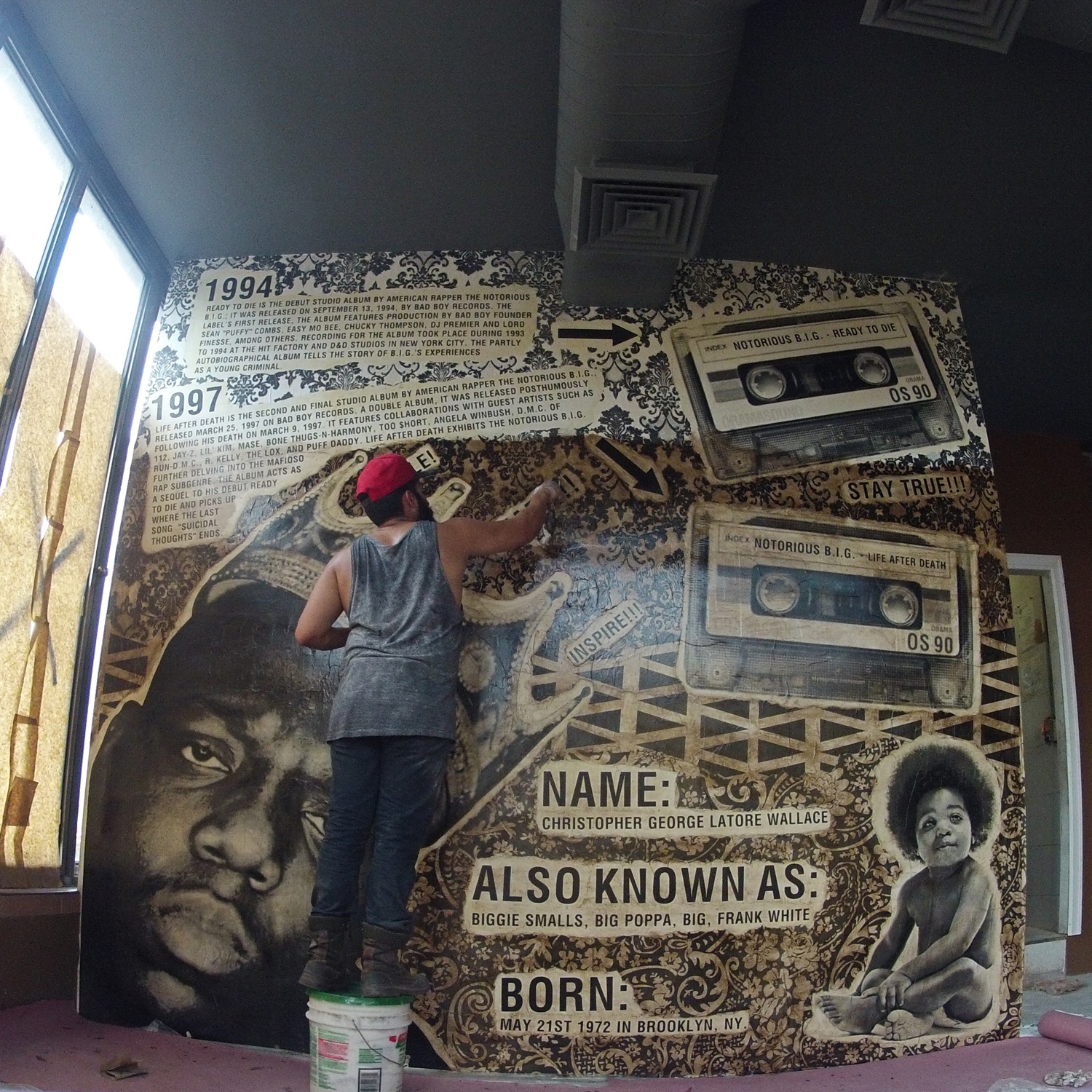 Ivan Orama  working on one of his walls at  Hello Bklyn .