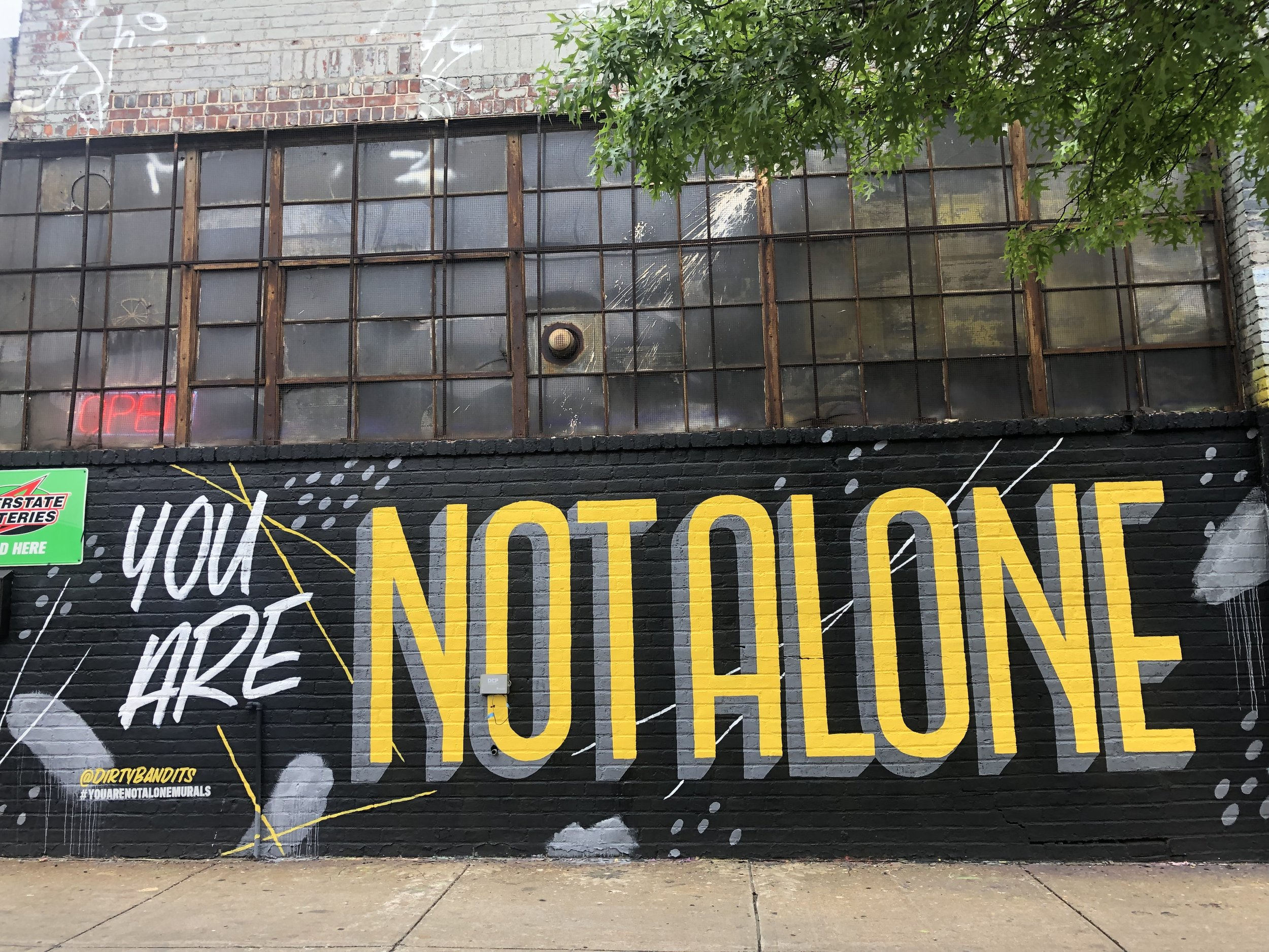 You Are Not Alone mural in Greenpoint, Brooklyn by Dirty Bandits.