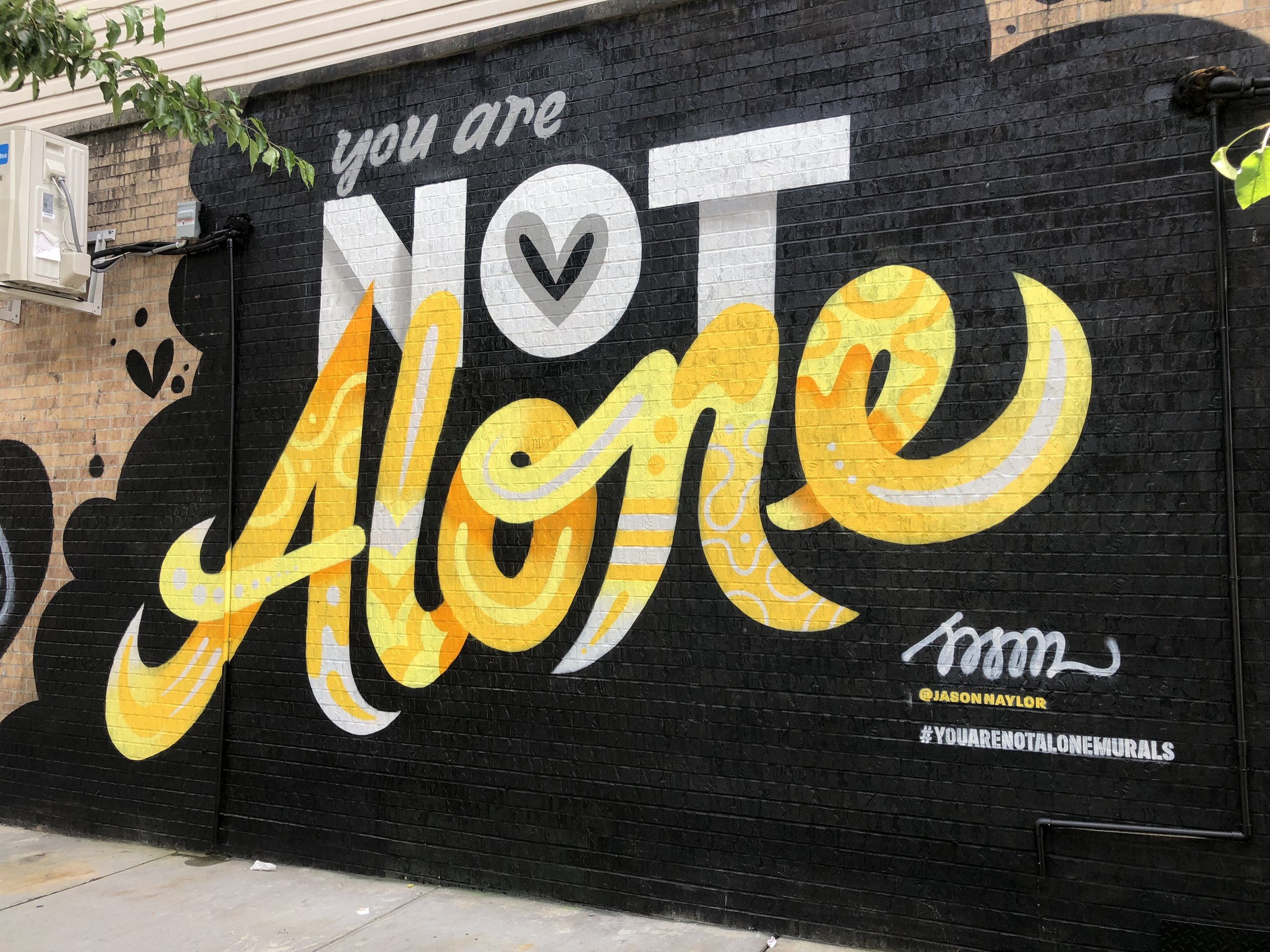 You Are Not Alone mural by Jason Naylor in Bushwick.