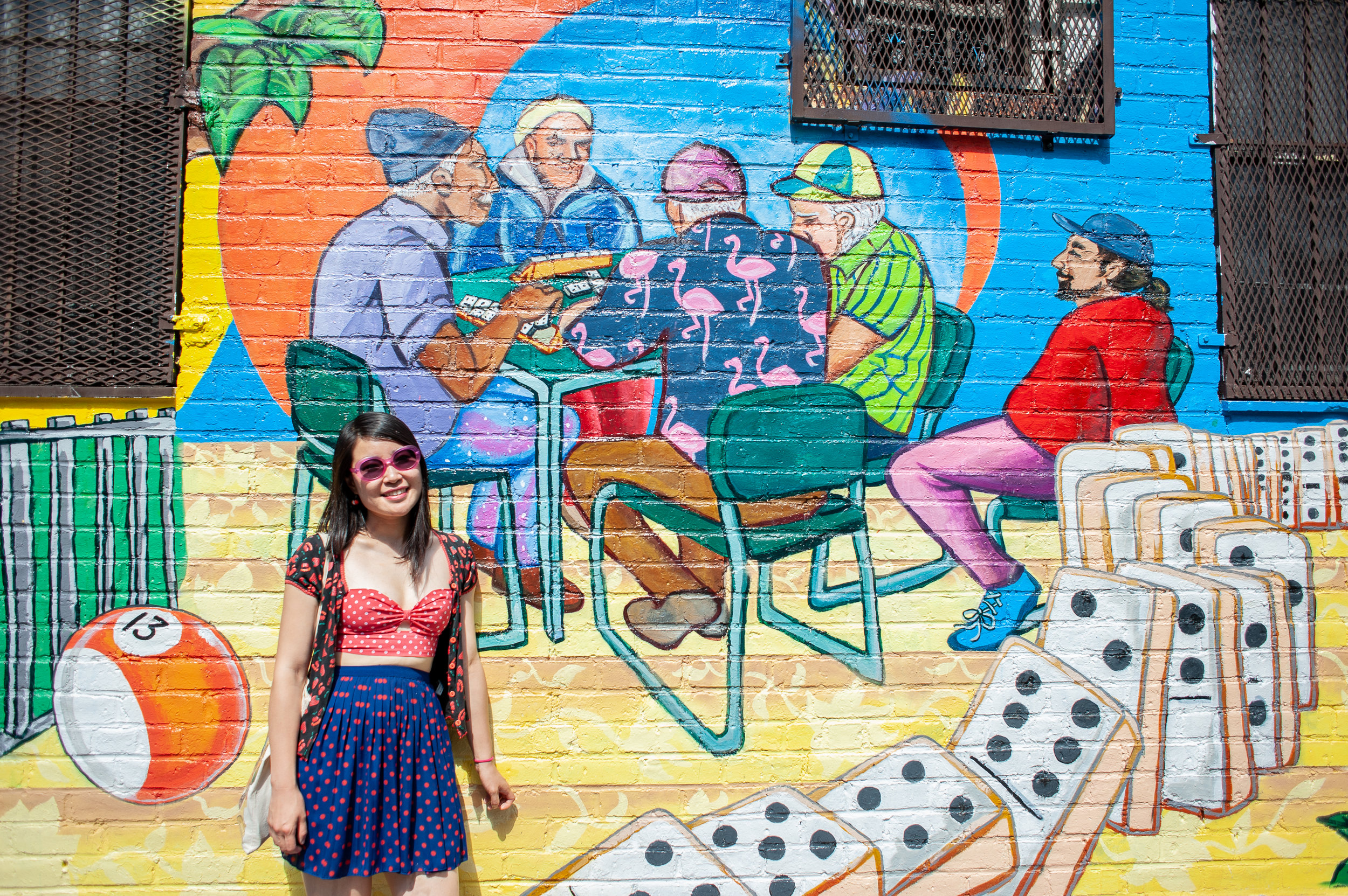 Peach next to a Thrive Collective mural she helped paint at Lillian Wald Senior Center in Alphabet City.