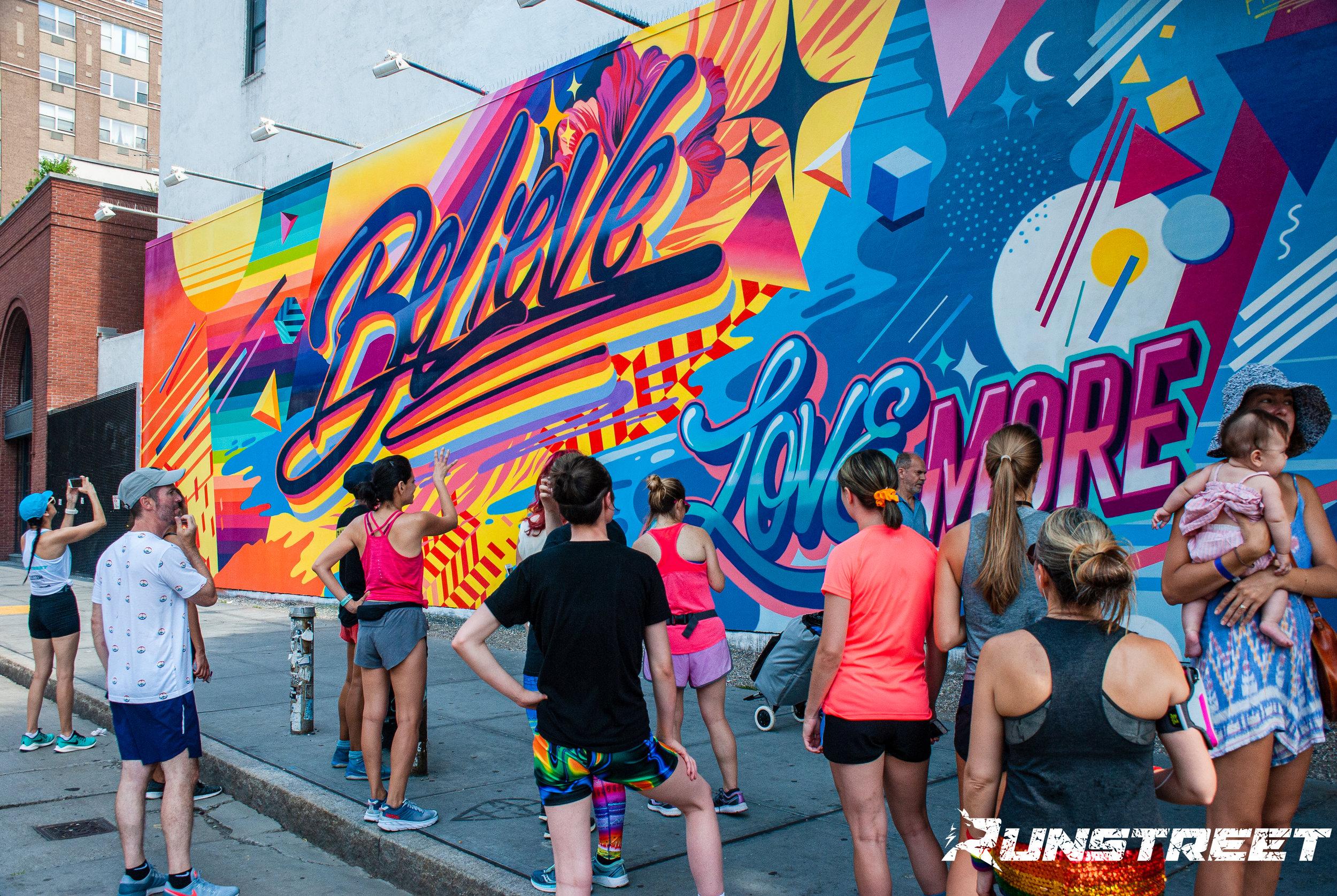 Runstreet Pride Art Run photos by  Marques Jackson . Love mural at the Bowery Graffiti Wall by  Queen Andrea .