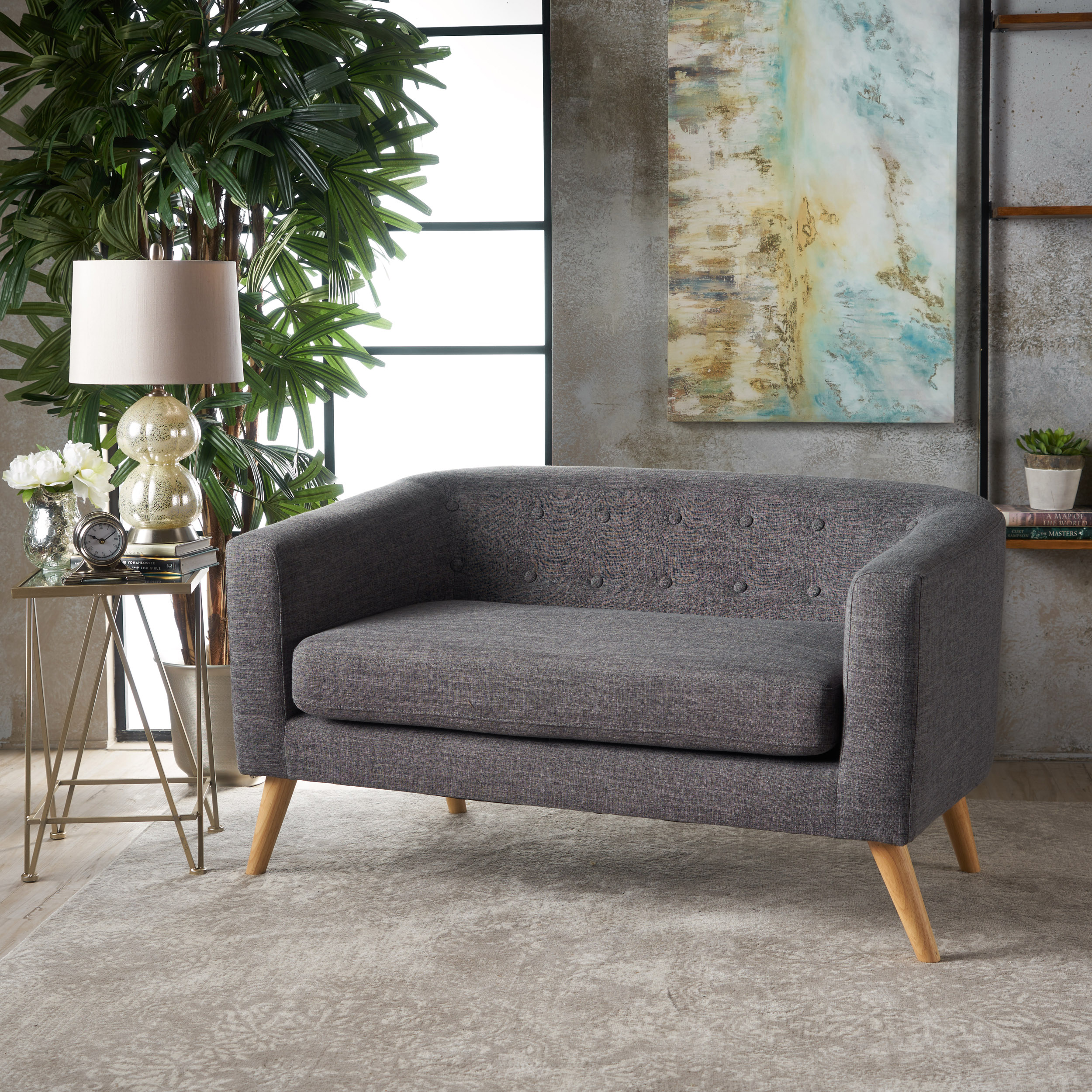 noble house loveseat - $168.98  not the most comfortable but looks cute. the more i look at it the more i think it's just for hipster dentist waiting rooms