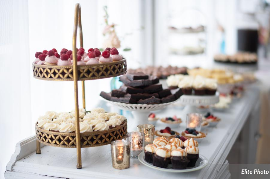 This Sweets Table has a nice variety of desserts and included Mini Cupcakes, Tiny Cheesecake tarts topped with fresh fruit, Brownies, and Lemon Bars.