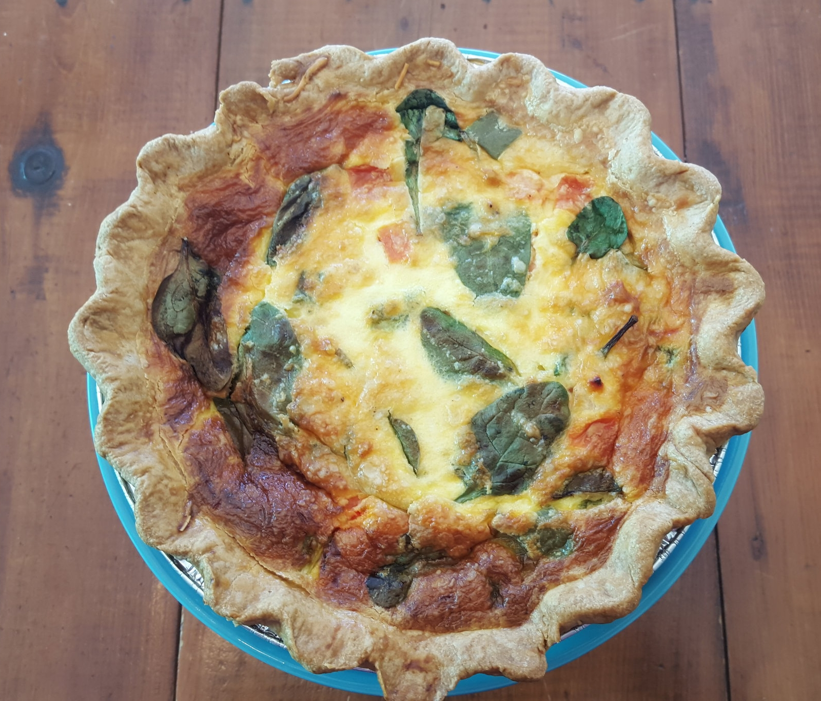 Sugar Sister Quiche - Our Quiche comes in two flavors: Cheese and Veggie. Veggie is made with Cheese, Green Peppers,Tomatoes and Spinach. Quiche can be ordered Take n Bake (comes frozen and you bake at home). Please specify your preference when ordering.