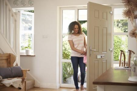 Woman entering her new front door in Spokane, WA
