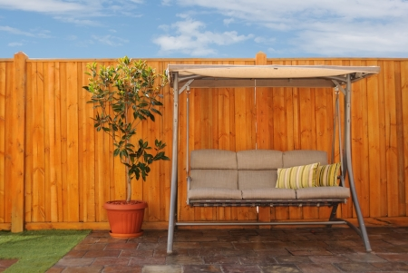 Beautiful Wood Fence in Backyard with a Swing Chair in Washington