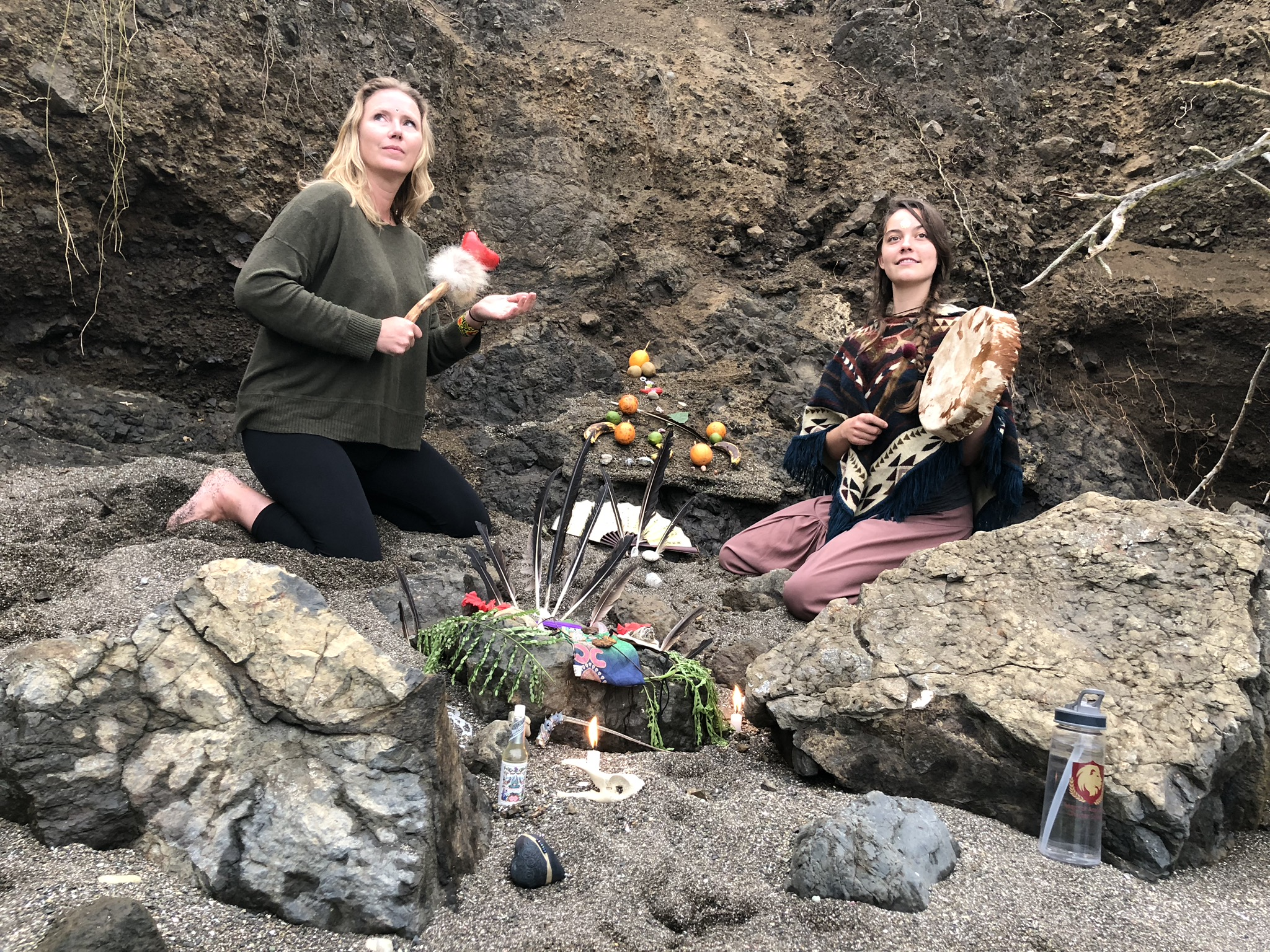 Jessica Grotfeldt and Abbie Hiduk preparing the altar and space by the ocean
