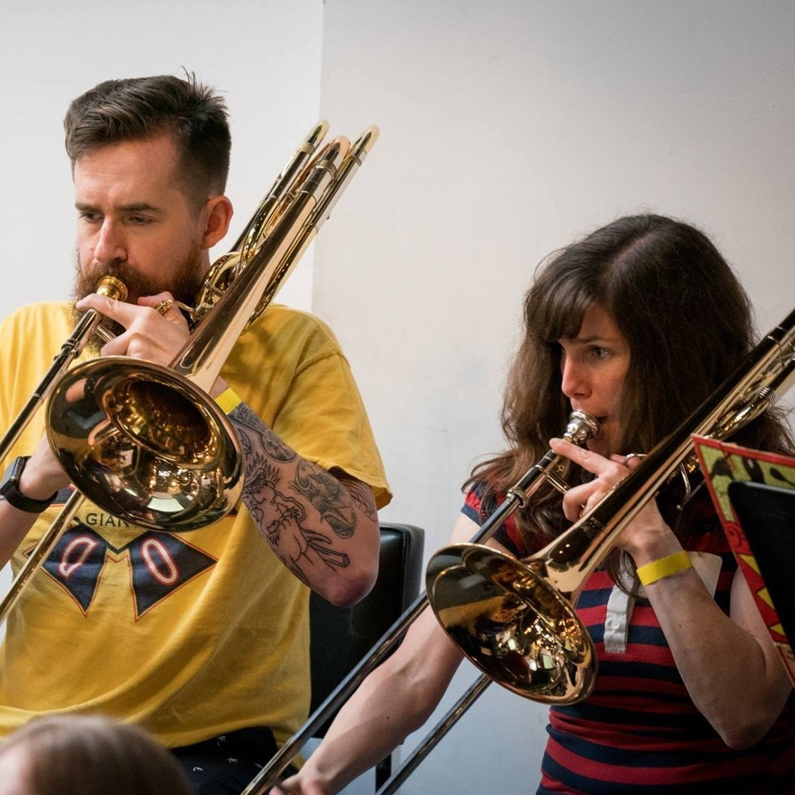 TROMBONES, EUPHONIUMS, TUBAS:    Bonnie & J. Maddox     Bonnie and J. first met in their community college jazz band and later graduated from Pacific Conservatory of Music. Their first Awesöme Orchestra experience was playing in  UnderCover Presents: A Tribute to Green Day's Dookie.  It's been a fantastic voyage from selling koozies and t-shirts at the welcome table to recording at Fantasy Studios and Zoo Labs and performing with the AÖ Big Band for Prom 2019! Outside of AÖ, Bonnie and J. are music teachers and perform with a variety of musical groups.