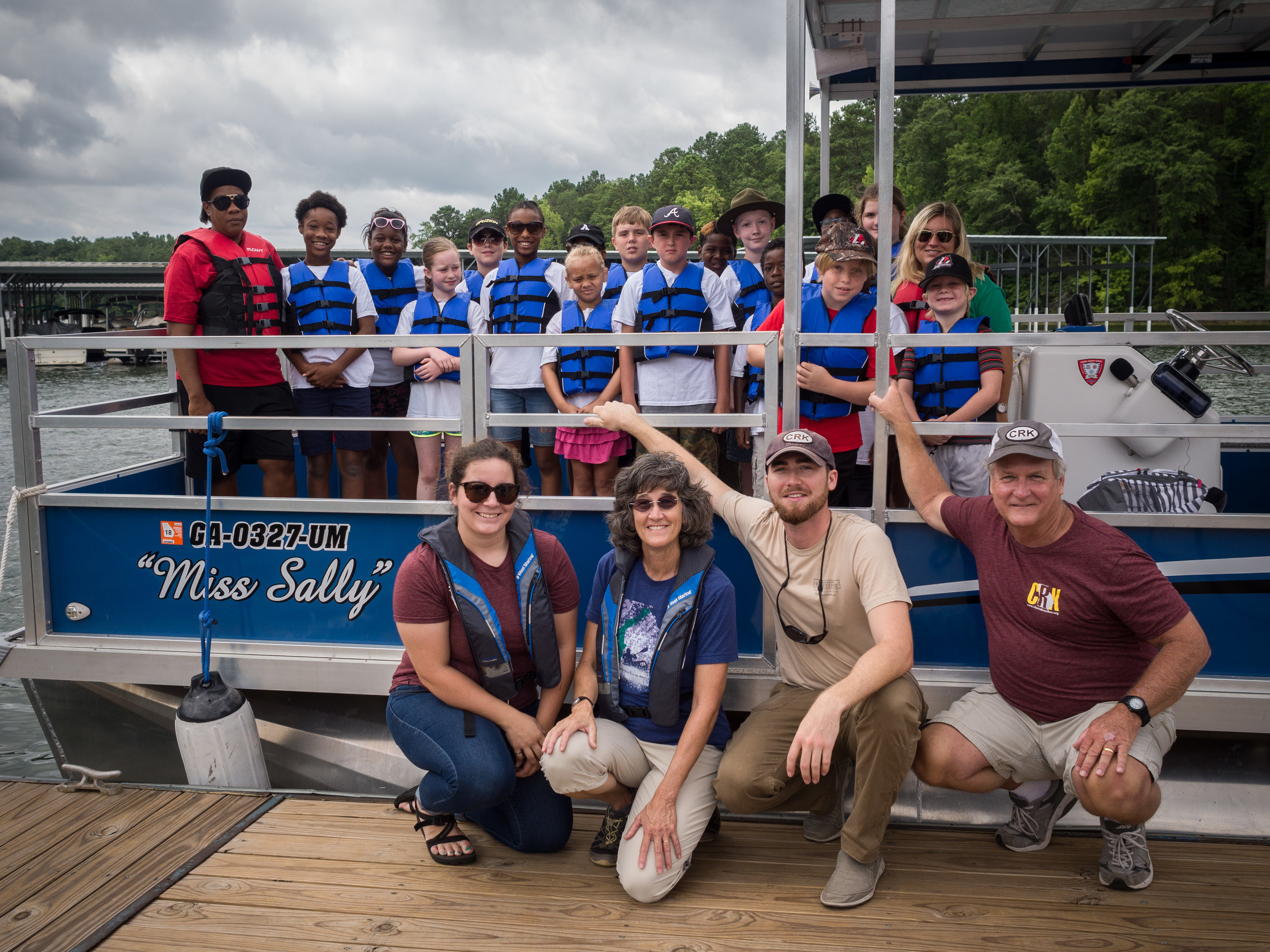 Headed out for a program on the Miss Sally. CRK staff pictured kneeling from left to right: Hannah Bradford, Laura Breyfogle, myself, and our boat captain Jim West. July 28, 2016.