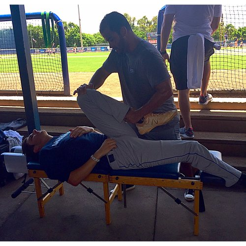 ONE OF OUR SOUTH FLORIDA COLLEGIATE LEAGUE ALL-STARS GETTING STRETCHED OUT BEFOE THE BIG GAME AT FAU