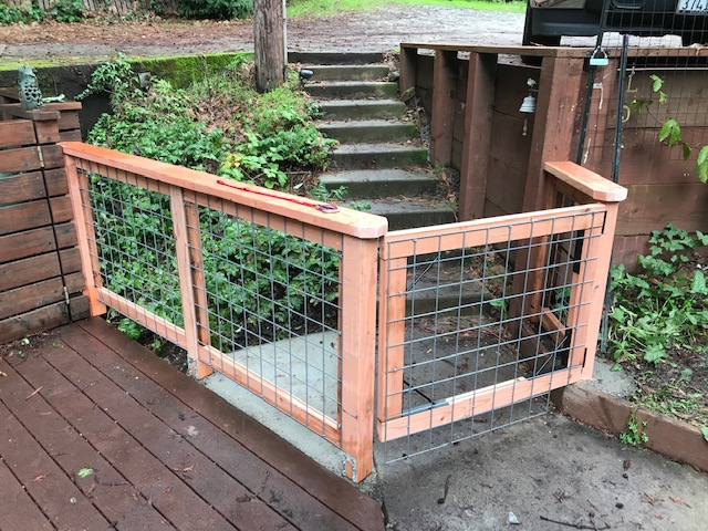 A redwood-framed hogwire fence and gate I built recently in Felton . . . This was the final touch to enclose an awesome yard and deck for one cool little dog!
