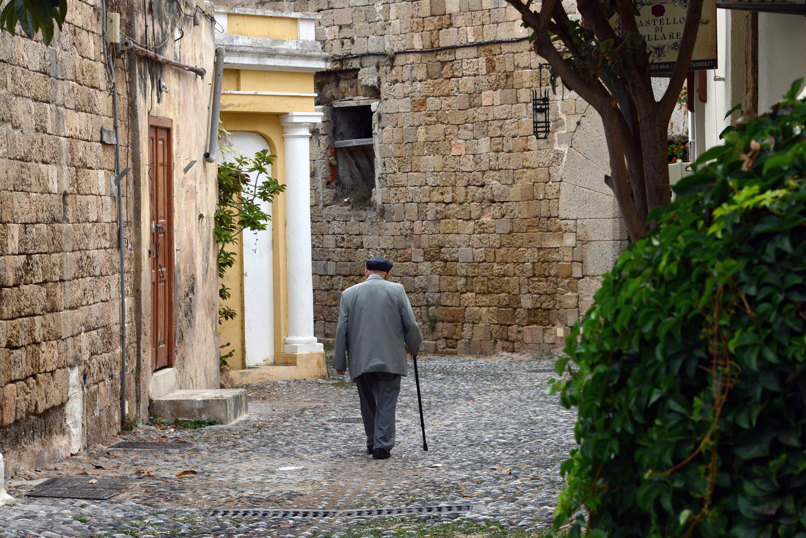 Following Shira's Journey - Shimon Cohen in the old city of Rhodes. Shimon is a Survivor in hiding, originally from Volos. He fought with the Greek Underground and after the war he went to Palestine and fought in the 1948 War of Independence of Israel. In 1956 he returned to Greece and settled in Rhodes. Photo Emanuel T. Santos.
