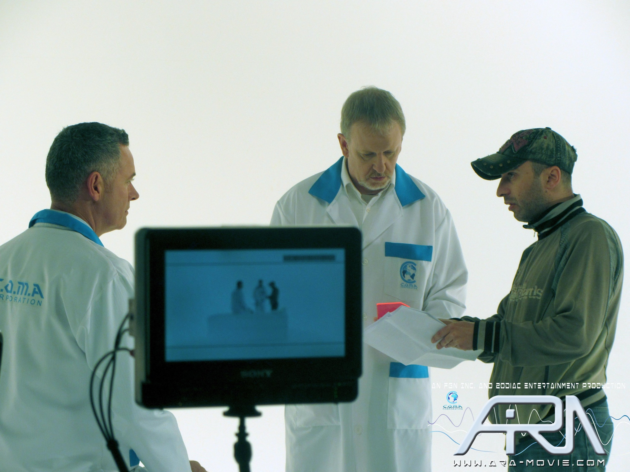 From Left to Right:    Tony Scahill (Jason), Kevin Harty (Dr. Styles) & Director Dimi Nakov discuss one of the scenes.   Photo Credit: Rakesh Raj