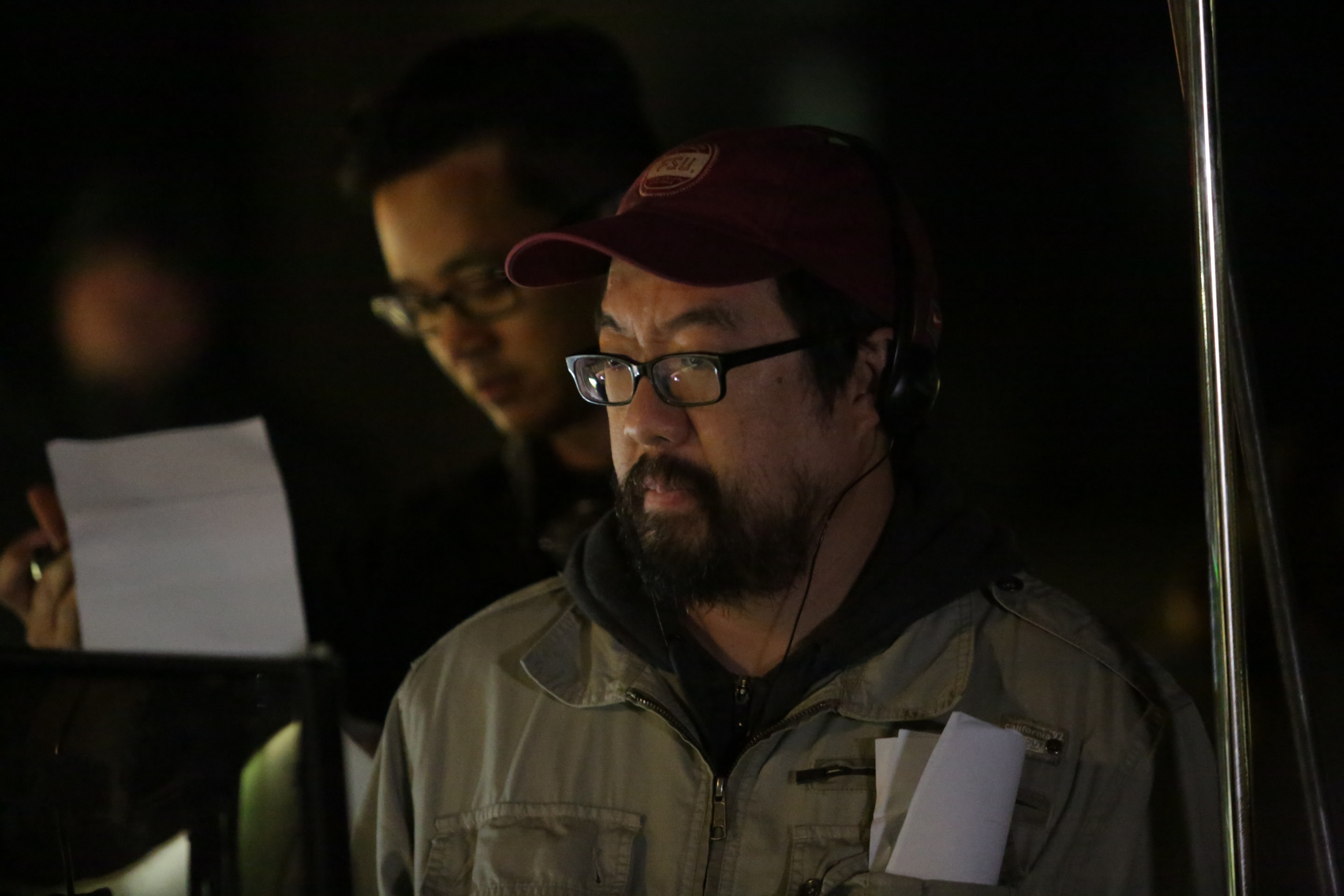 Comfort director William Lu watches a scene on the monitor. Image courtesy of Late to the Party Productions.