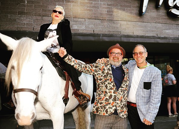 Rose Hartman on top of a white steed at the film's premiere at SXSW 2016. She is holding hands with Director Øtis Mass. Photo: The Artists Company.