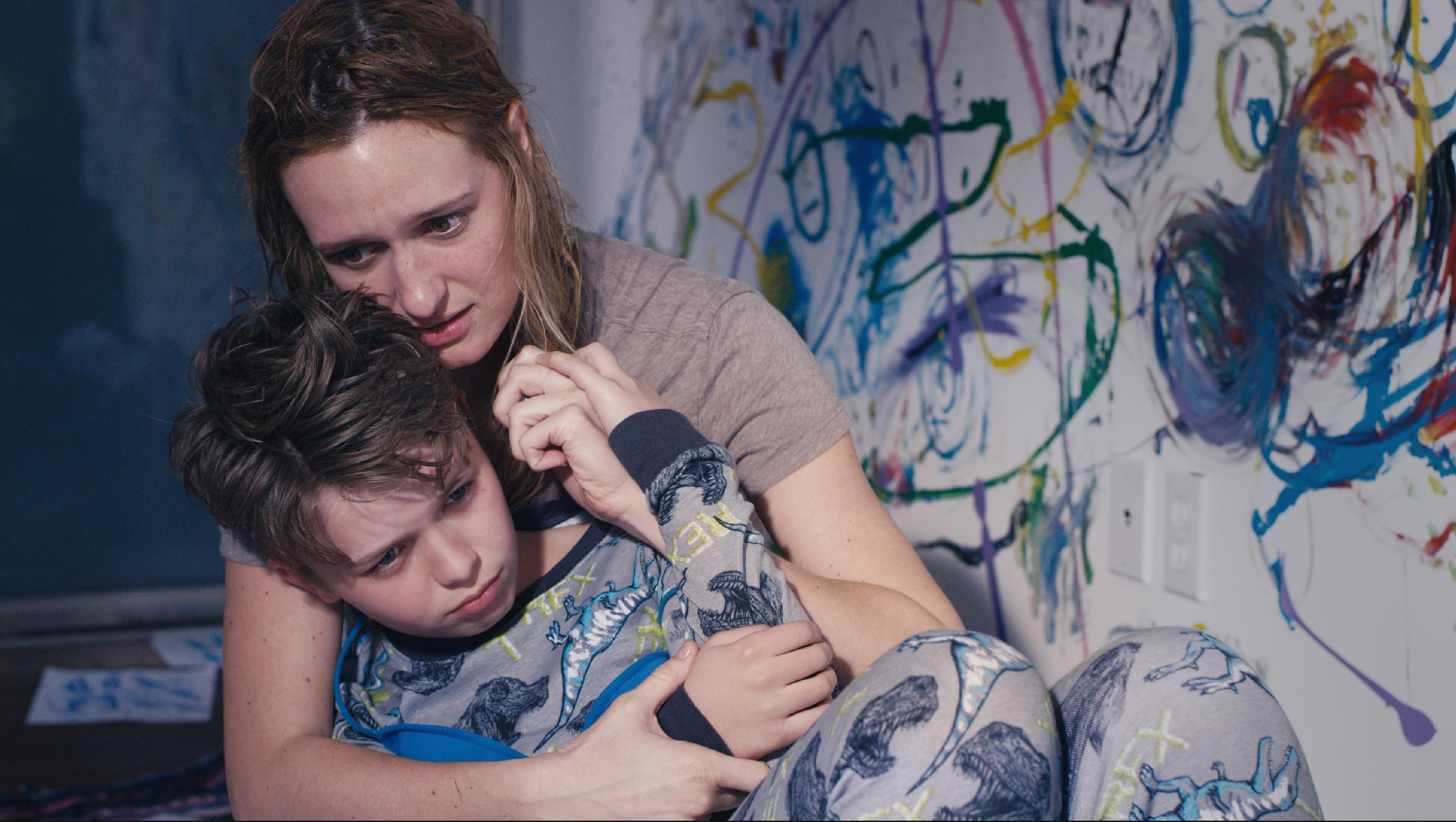 Miranda, Adam's mother, played by Breeda Wool.