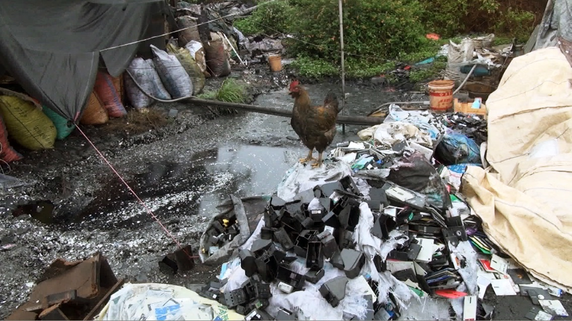 .Pile of waste in one of China's e-waste villages where the primitive dismantling of electronics poisons local communities and pollutes the soil, air and water.
