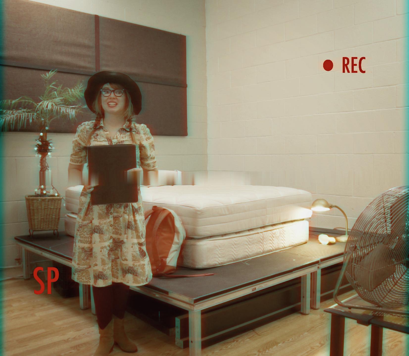 Janice (Natalie Palamides) slates for an awkward audition.