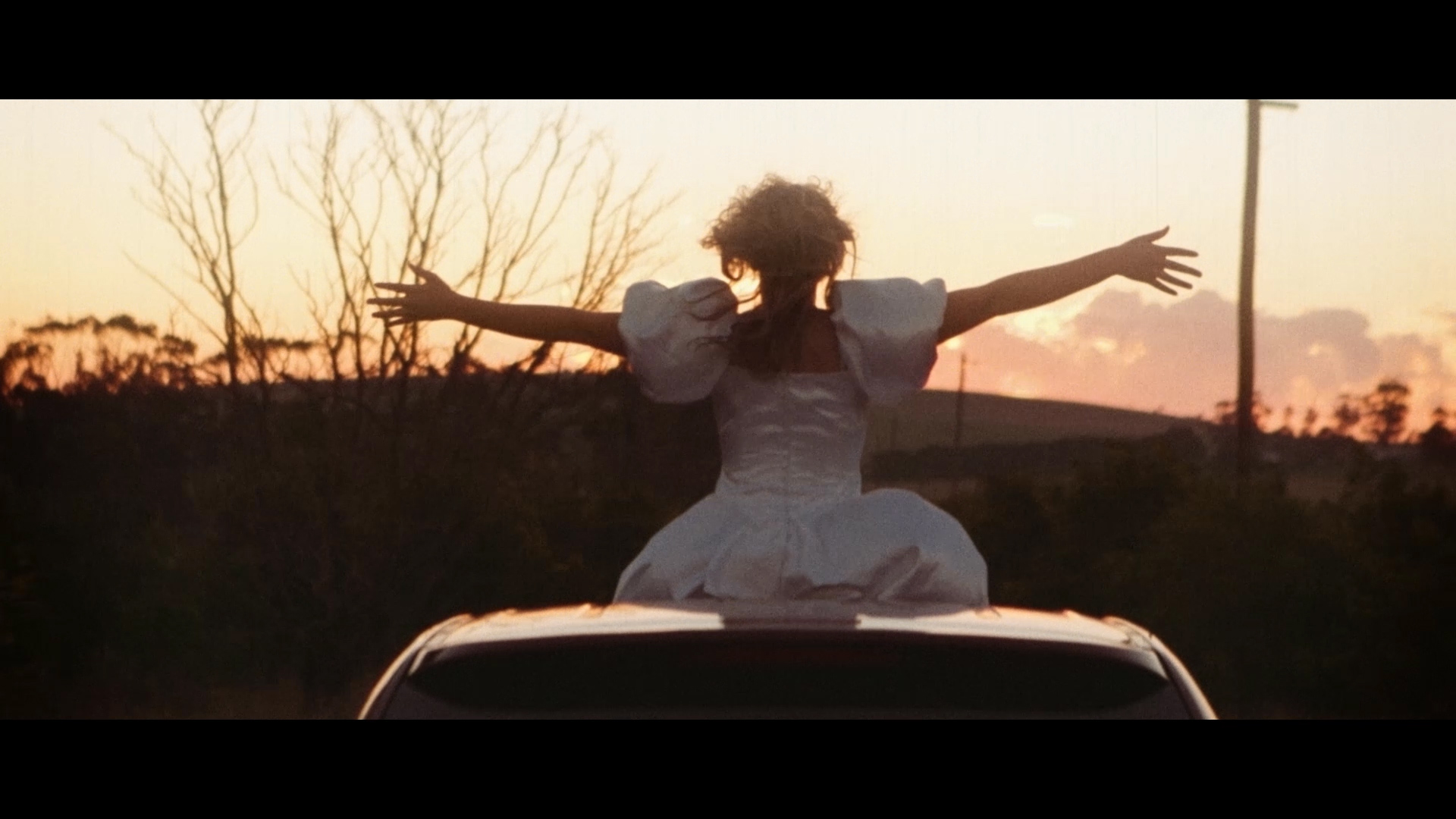 The Happiest Day of my Life - Raptuously Becky (Jeni Bezuidenhout) embraces the fading light of the happiest day of her life.