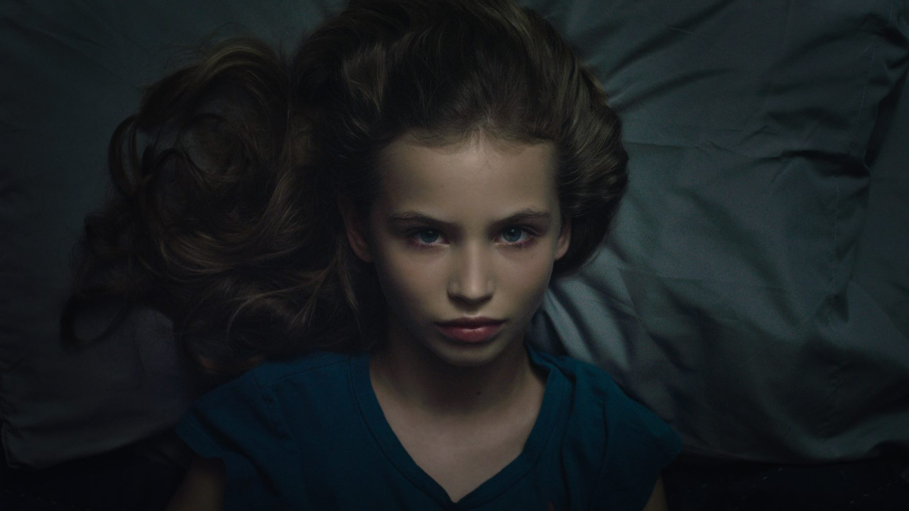Break My Bones: Violet awake in bed at night.