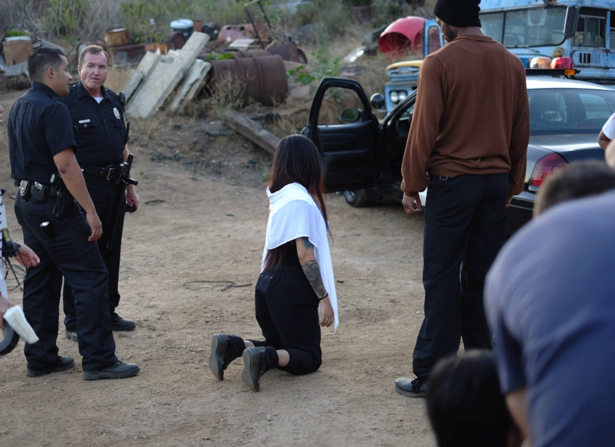 Behind the scenes- The director is putting herself on the ground to find the mark for the actor instead of letting him lie on the dirt.
