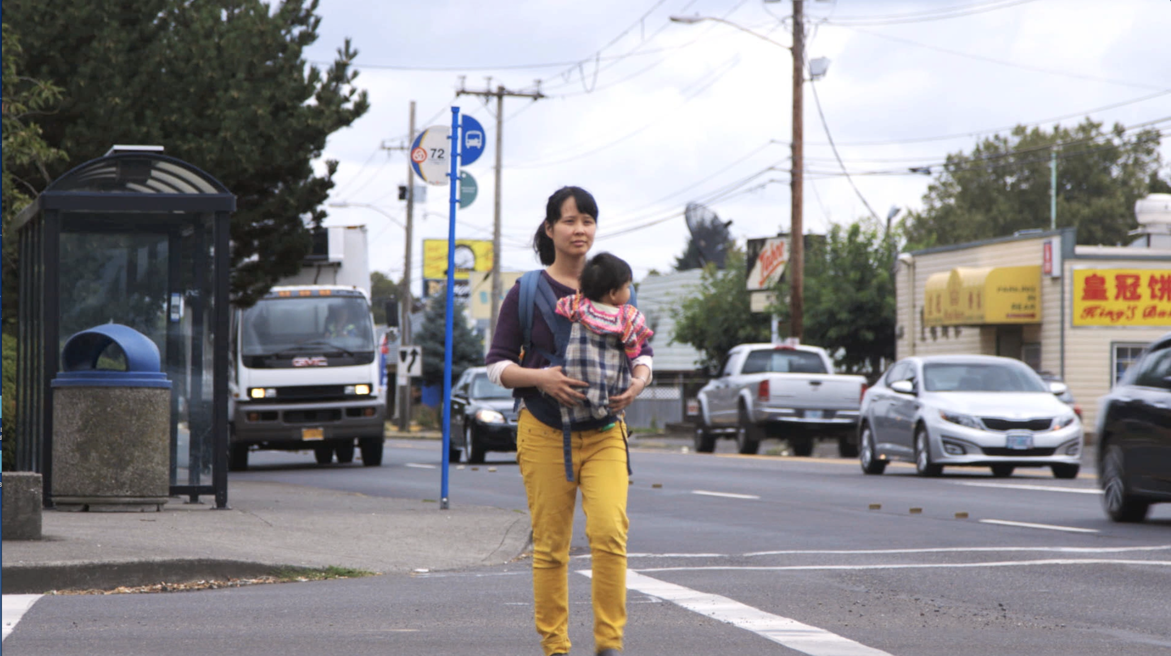 Khanh crosses street: Khanh Pham and her daughter at SE 82nd and Division, an intersection that scares her.