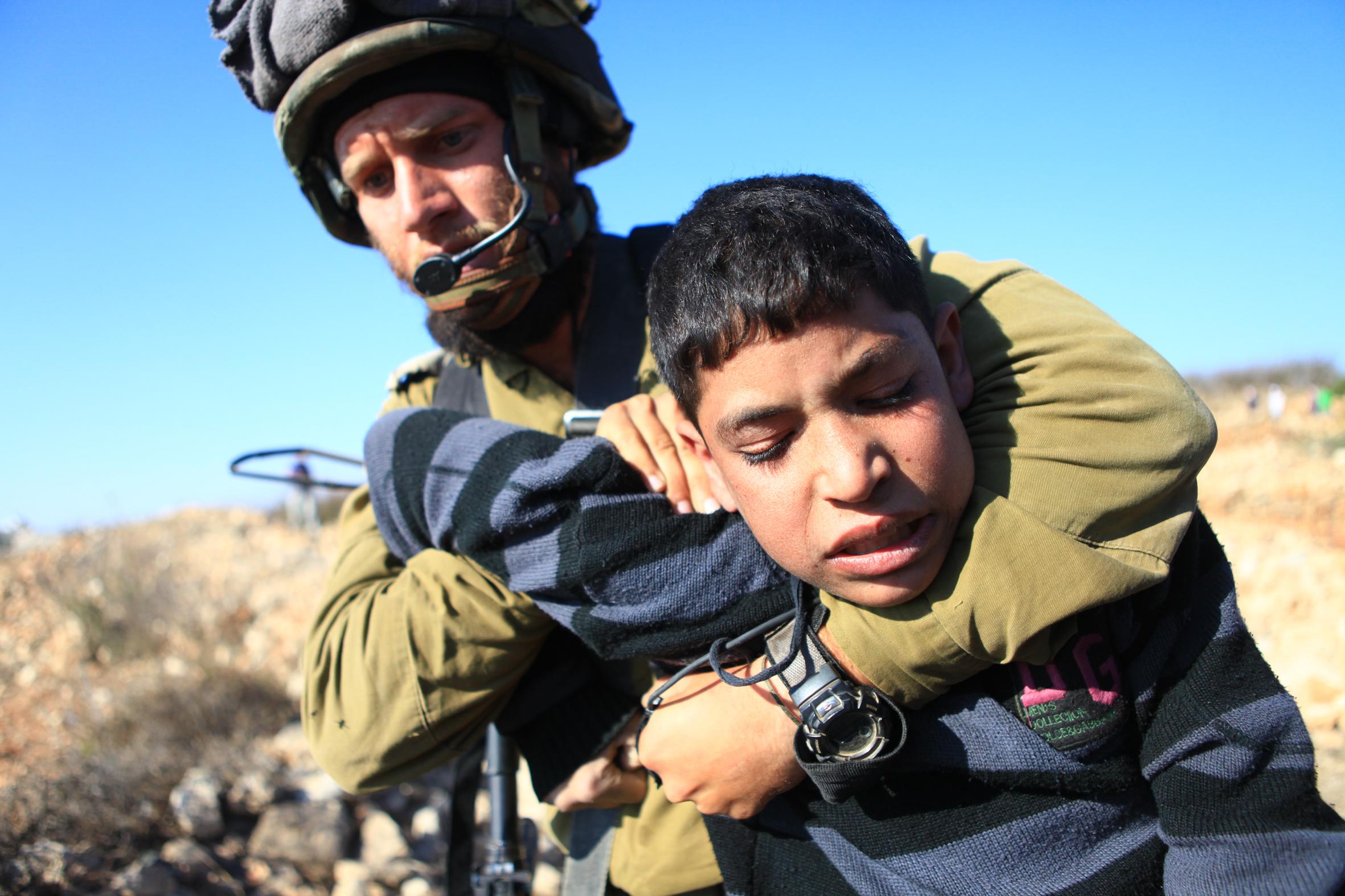 Jews Step Forward - IDF choking child.