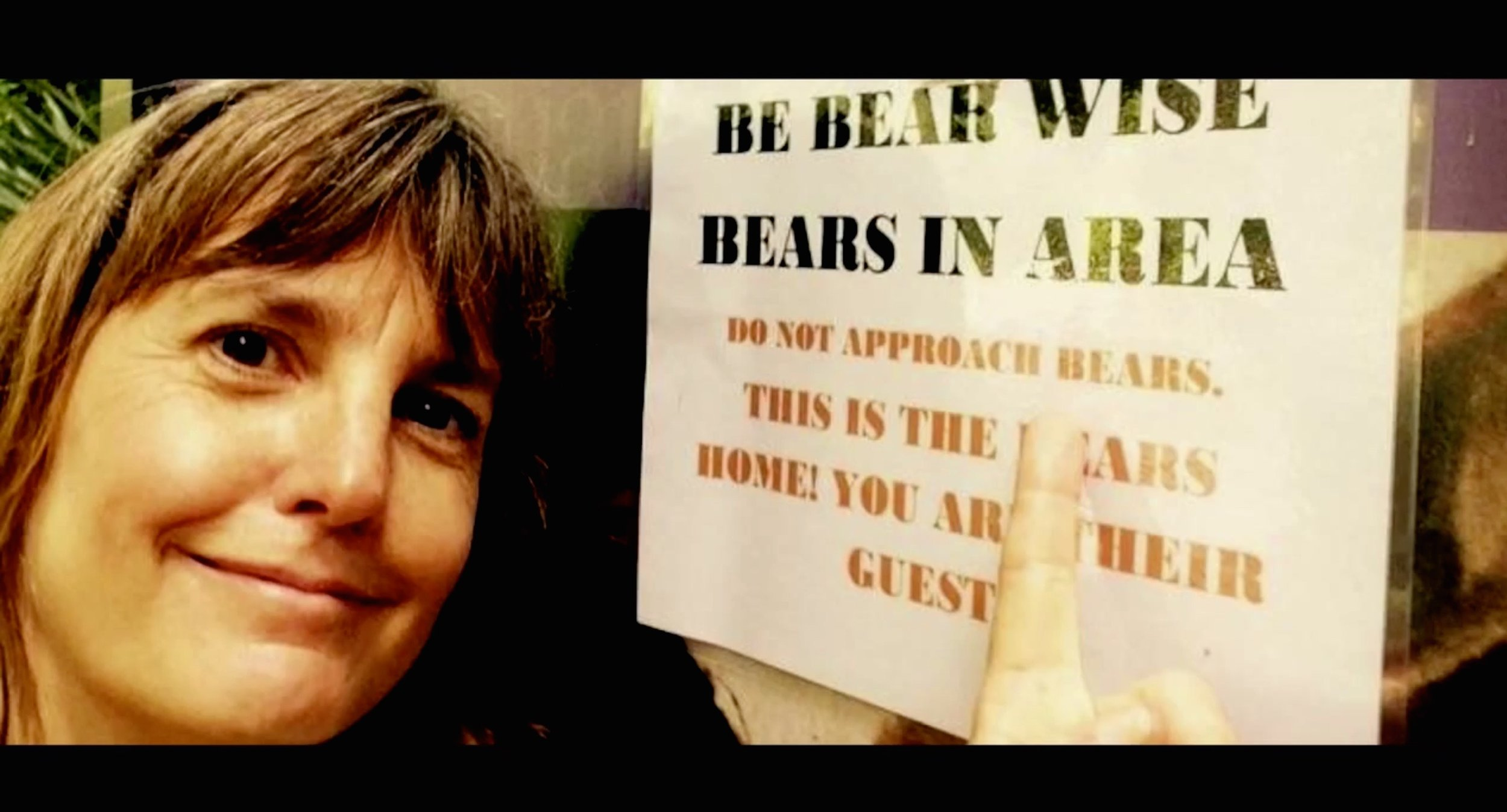 The Perfect Selfie - Selfie with a biologist near a sign about bears being nearby. Several people get too close to them for selfies.