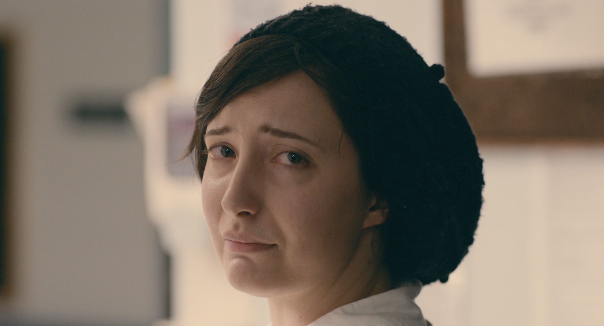 Adherence - Maddy makes eye contact with Charlie near the conclusion of the film, while she waits for her medication.