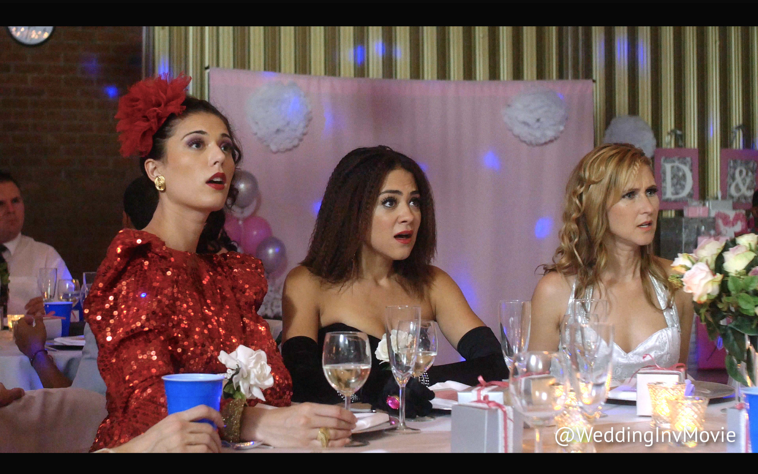 Nectar (Christina Ulloa) Ryann (Camille Guaty) and Lucy (Rainy Kerwin) get a shock when they discover something fascinating at the wedding.