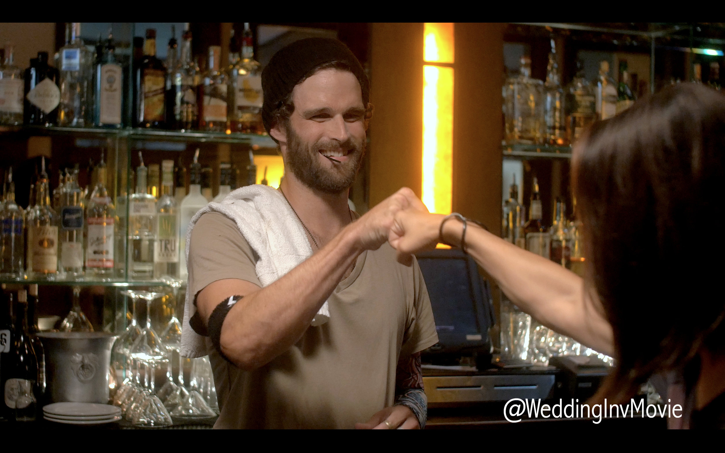 Chris (Nick George) plays along with Ryann's crazy flirtations.