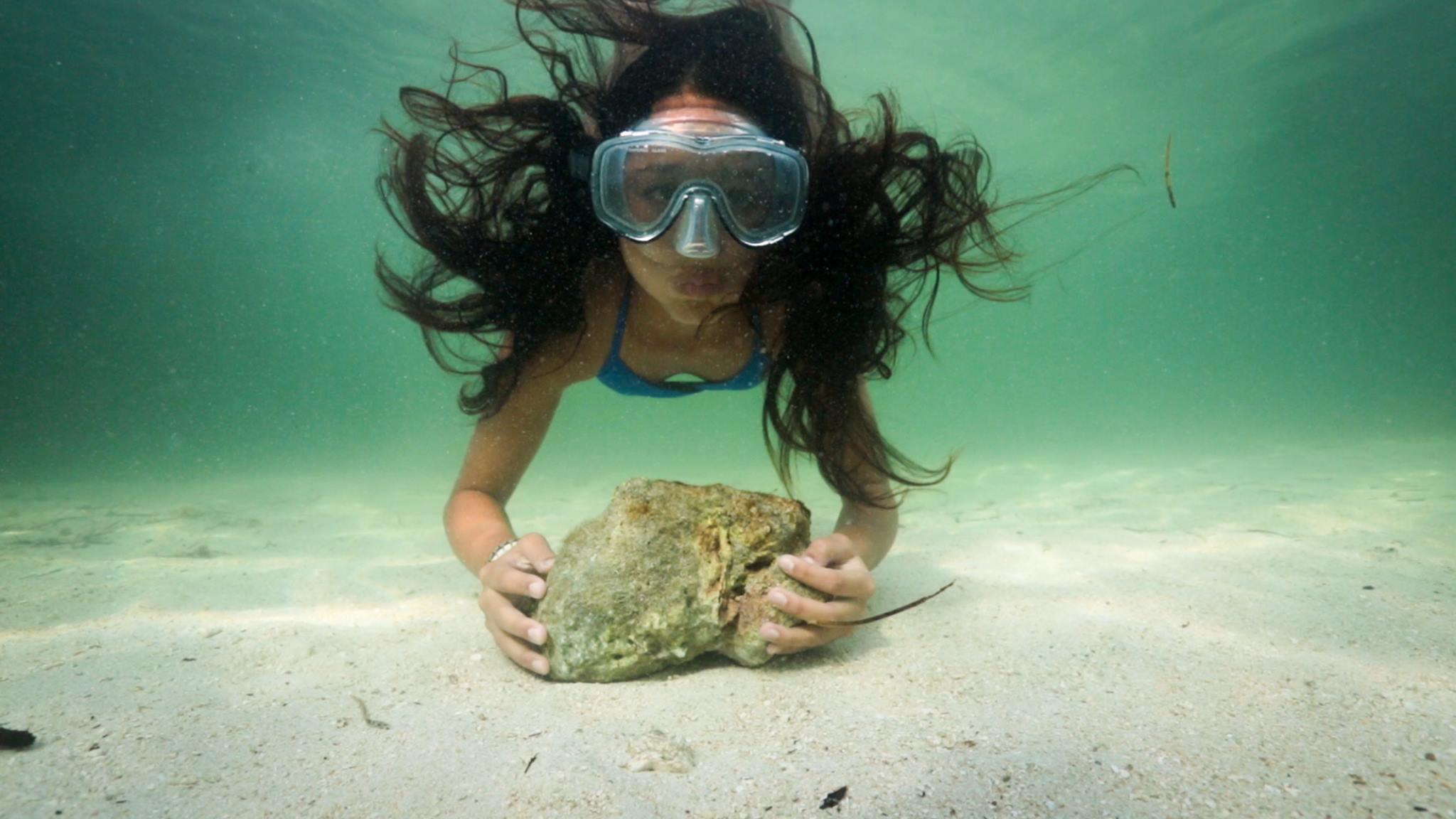 My Haggan Dream - Kaya tries to hold her breath as a long as a sea turtle. Photo by Stephani Gordon