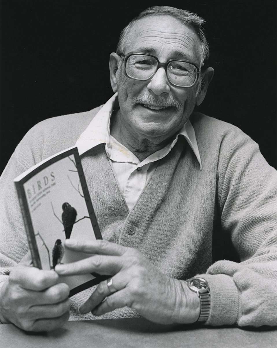 Far Afield: A Conservation Love Story - Bert with a copy of his book Birds of Grand Tetons National Park and the Surrounding Area. Photo credit: Jackson Hole News&Guide
