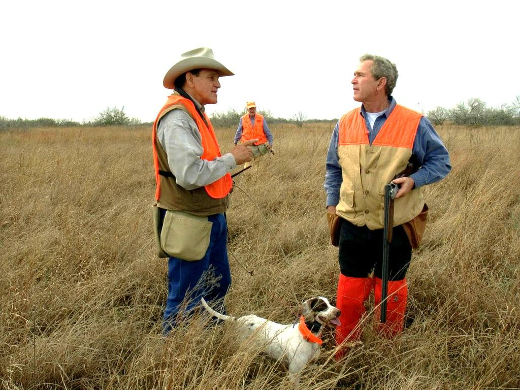 Lavoyger leads a hunt with Presidents George W. Bush and George H.W. Bush in the background.