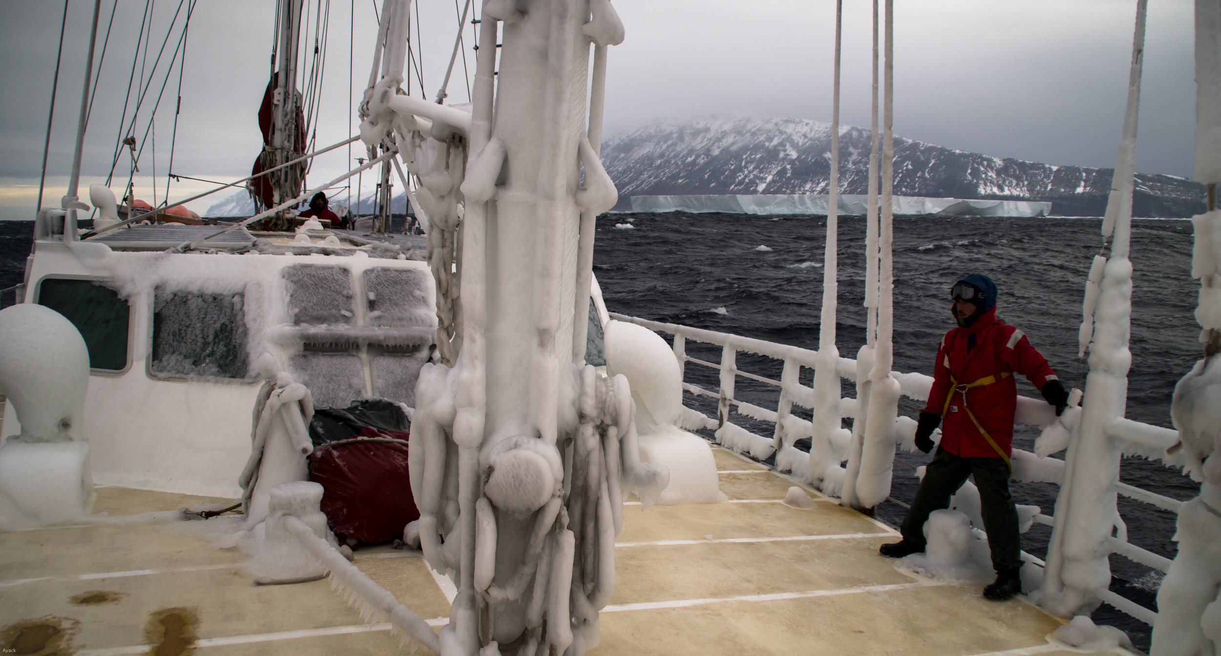 Sea Gypsies: The Far Side of the World - Danny on bow - Making our way through an ice-field at Cape Adare Antarctica at the mouth of the Ross Sea.