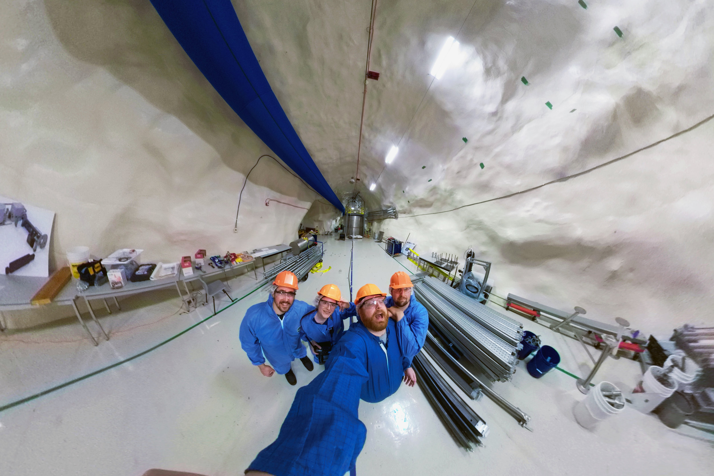 Canadiana  creators at SNOLAB, a world-renowned dark matter  facility located 2 km beneath the surface of the Earth in Sudbury,  Ontario. (L-R: Kyle Cucco, Ashley Brook, Adam Bunch, and Josef Beeby)