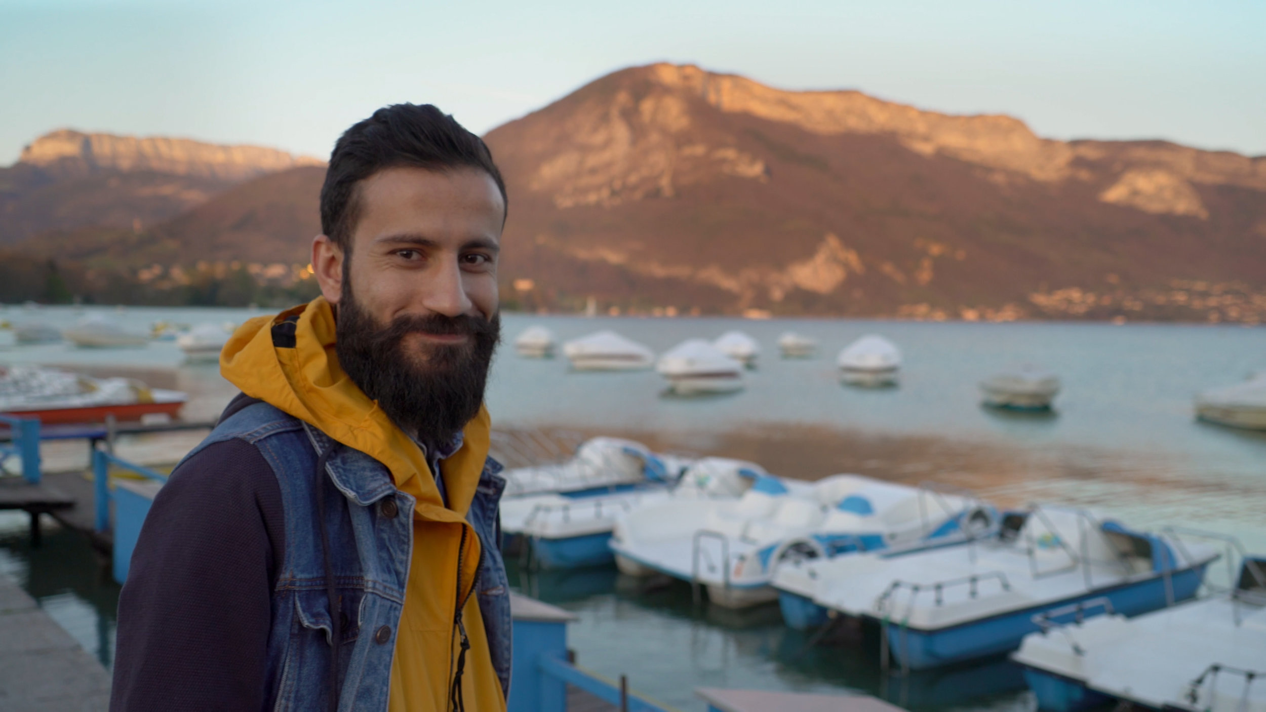Unbroken Paradise - Ramman Ismail smiling in Annecy, France, where part of the film was shot.