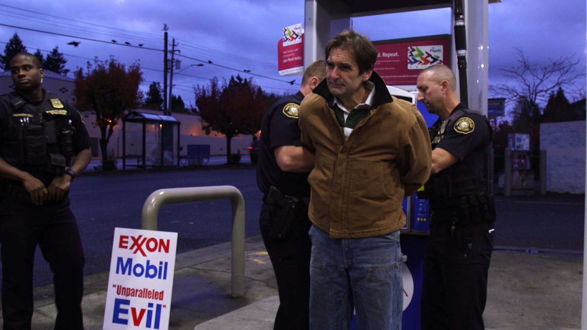 Ken Ward is arrested protesting Exxon Mobil.