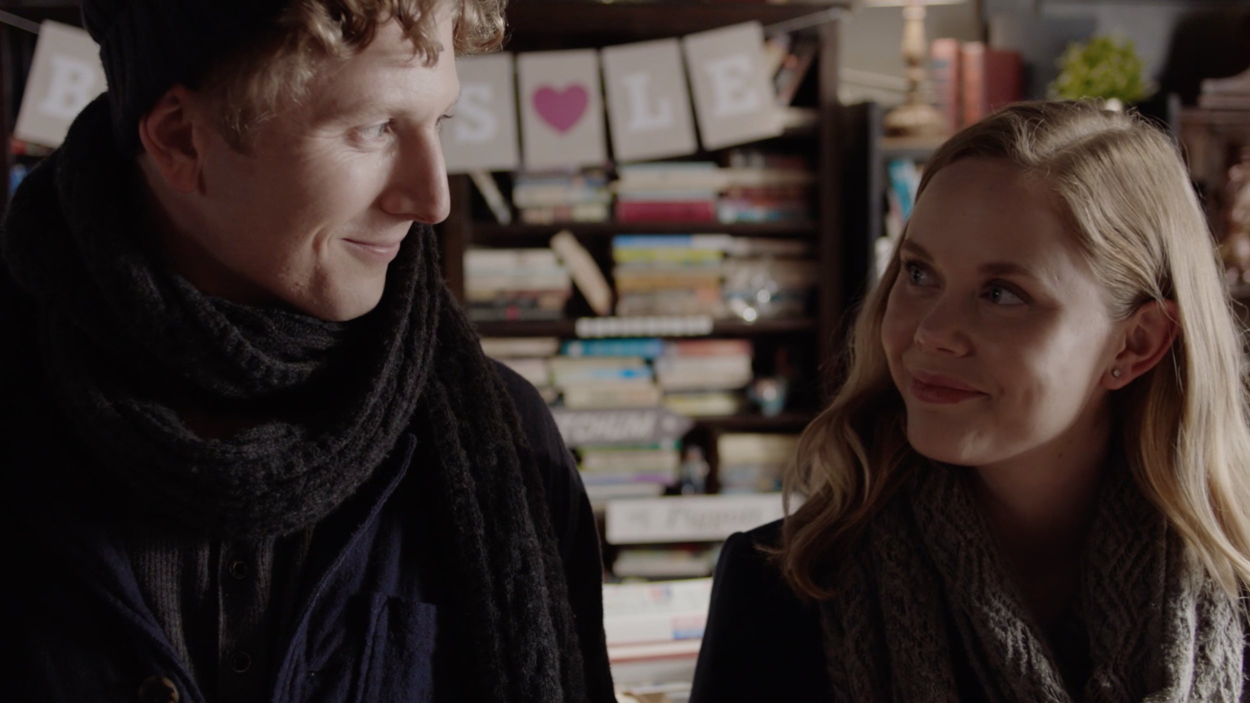 Donald (Alastair Osment) and Abbey (Emily Gruhl) starting to get to know each other in The Bookshop.
