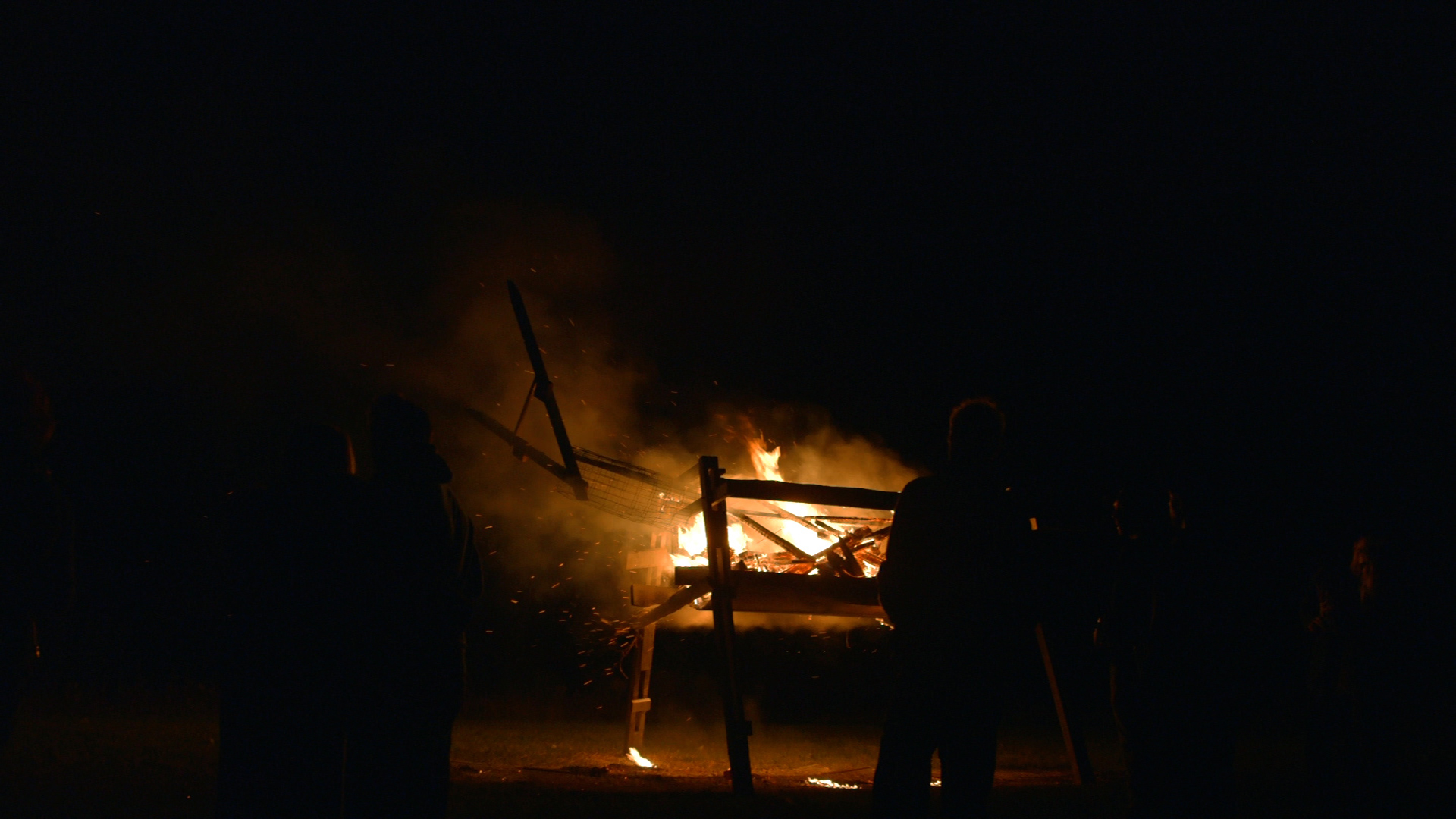 The giant wooden goat burns at Headwaters Farm as a tribute to the end of growing season and a successful harvest.