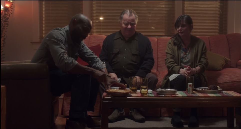 Actors Billy Brown, Peter Gerety, and Talia Shire share a meal in a scene from the feature film Working Man.