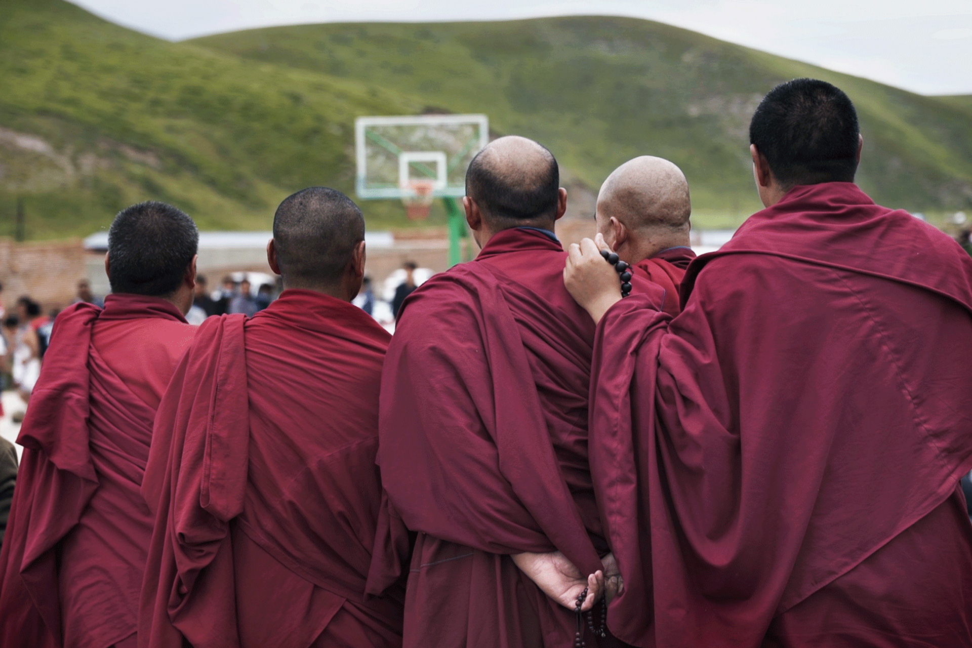 Monks Watching a Basketball game