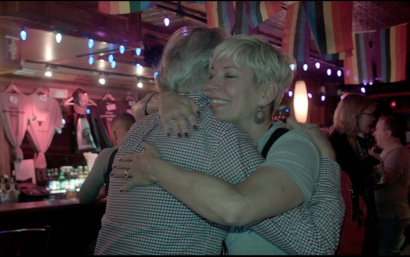 "Sara Cunningham offers free hugs at Stonewall Inn, the last stop on her first ""Free Mom Hugs Tour."""