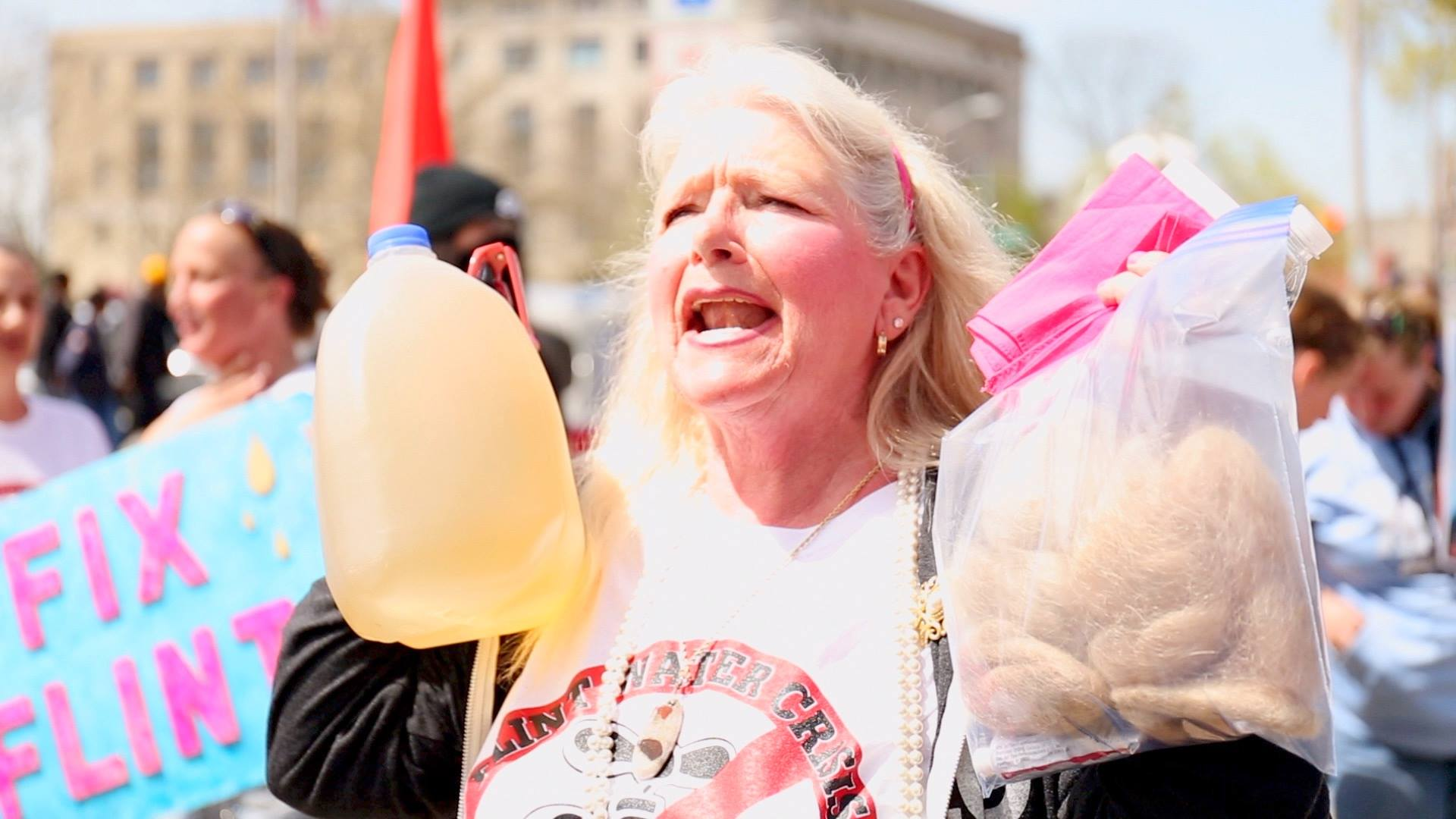 'Water is Life' at Standing Rock, Ojibwe water carrier Mary Lyons, Flint resident with her bag of hair and dirty water, Nayyirah Shariff leads Flint protest.