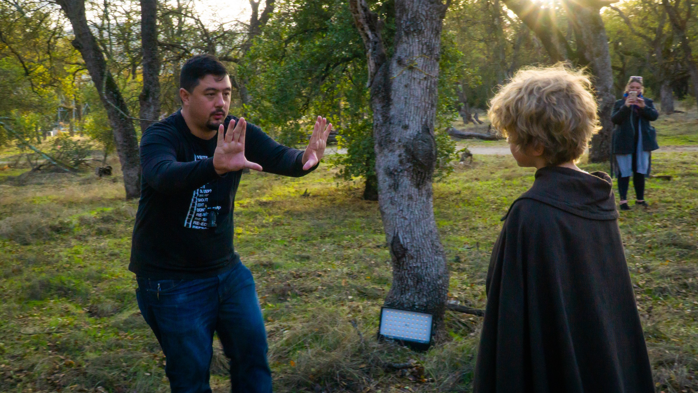 Director Sean McCarthy works with actor Erik Dyadchenko before a take.