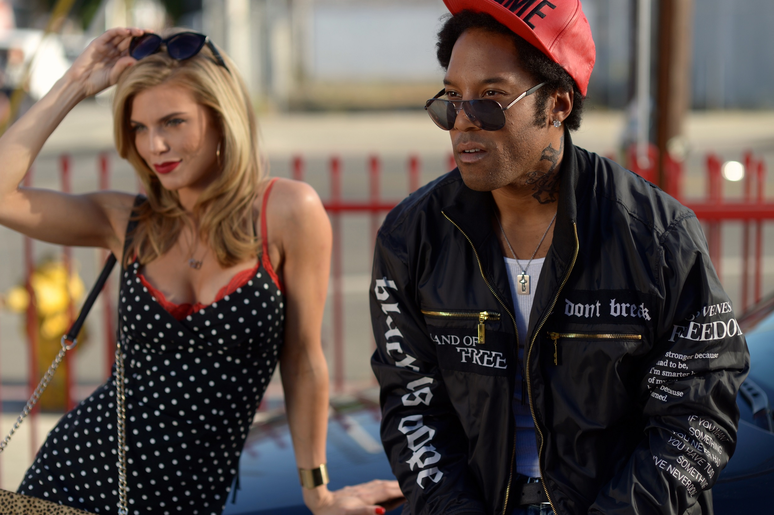"""AnnaLynne McCord as """"Divinity"""" and Johnathan Fernandez as """"Daddy"""" recruit at a milkshake stand"""