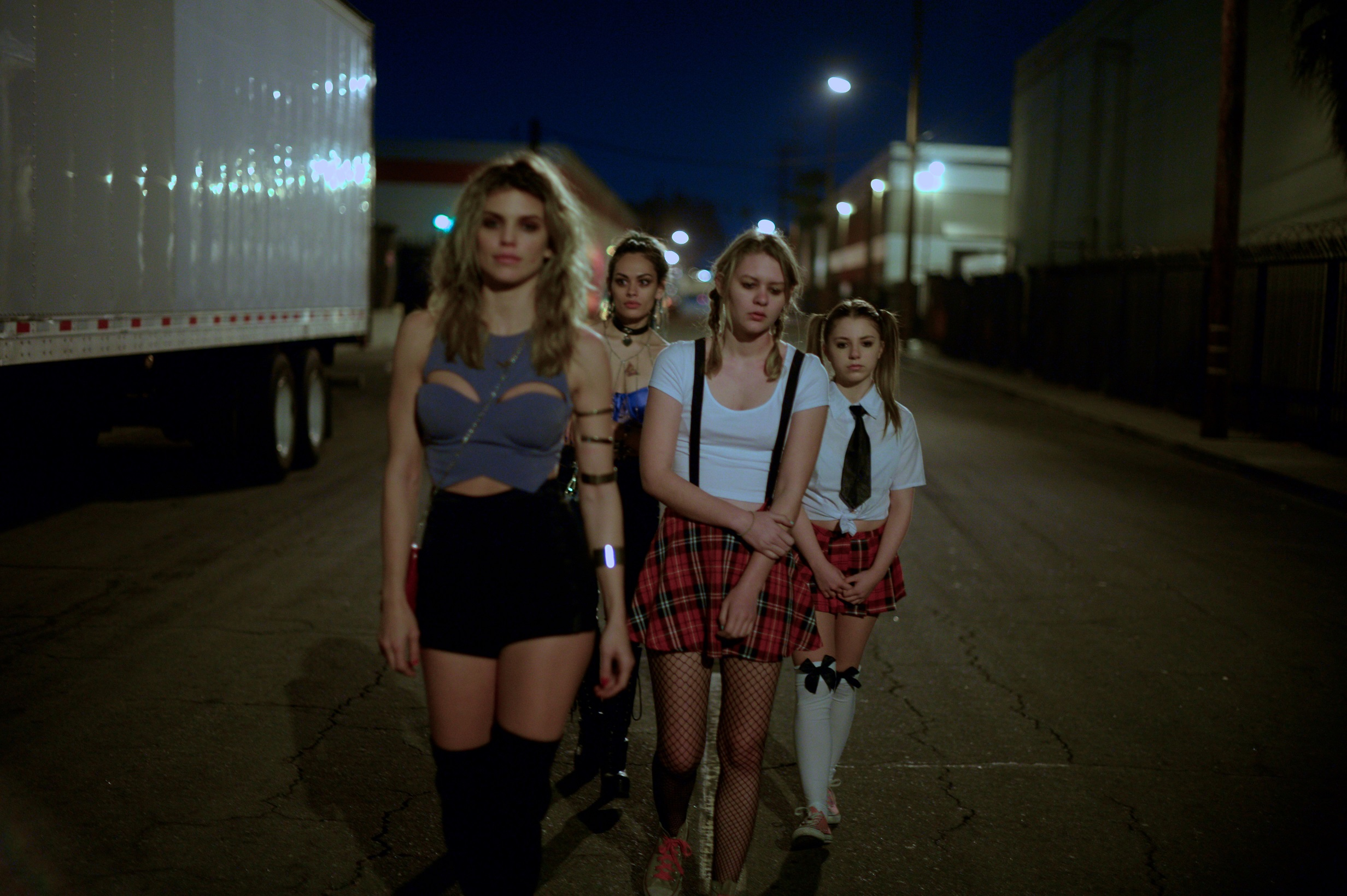 """AnnaLynne McCord as """"Divinity,"""" Natalia Warner as """"Bambi,"""" Ryan Simpkins as """"Jess"""" and Georgia T. Willow as """"Stella"""" work a truck stop"""